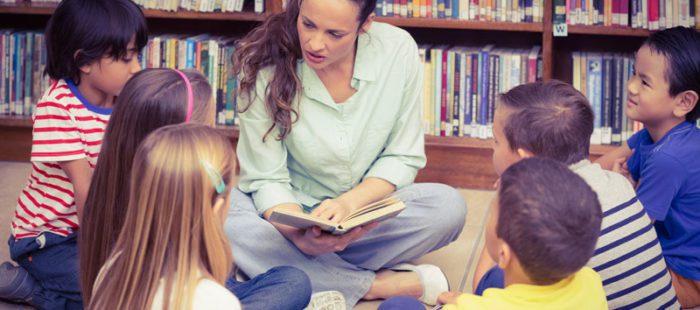 Teacher Reading in Library