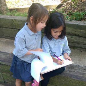 Libertas Students Writing Outside